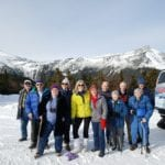 Group of Active Seniors Climb Mt Washington in Winter on a SnowCoach Adventure